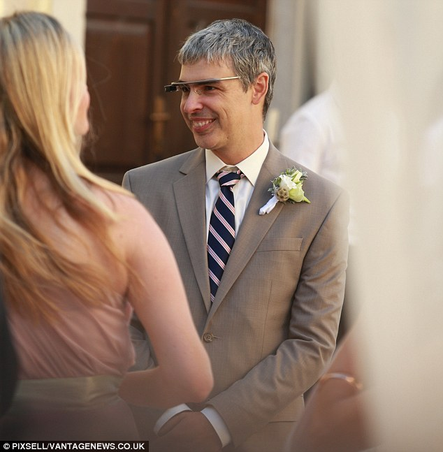 Distraction: Page talks to a wedding guest from behind his Google Glass