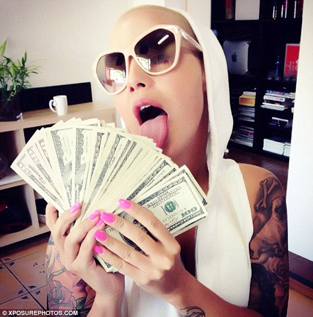 4825f51a78 Show me the money  Amber Rose posted a picture of herself holding handfuls  of dollars