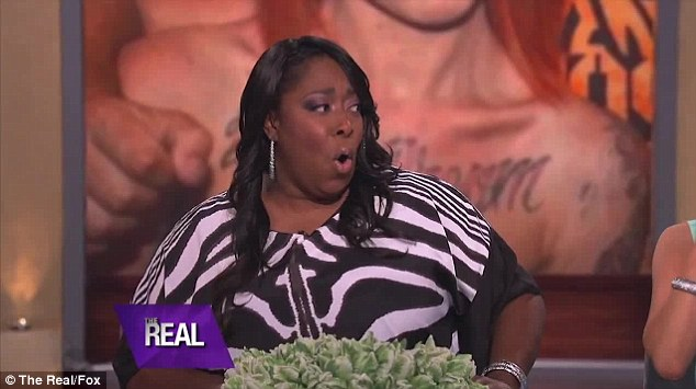 Shock horror: Loni Love was gobsmacked when Adrienne revealed her tattoo spells out the lengthy moniker Robert A Kardashian