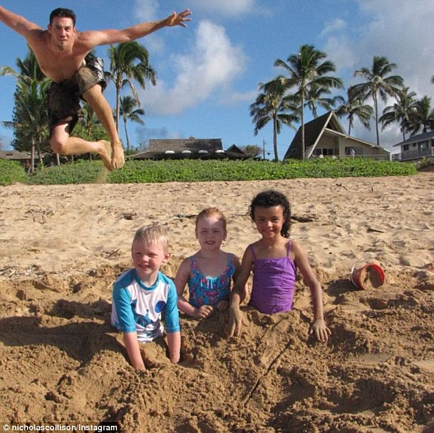 Gotcha! Oklahoma City Thunder forward Nick Collison photobombed a trio of yioung kids as they posed, half buried in a Hawaii beach