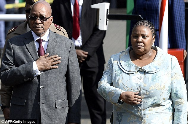 Milestone: South African President Jacob Zuma flanked by South African Defense Minister Nosiviwe Mapisa-Nqakula celebrate Mandela's birthday outside the hospital