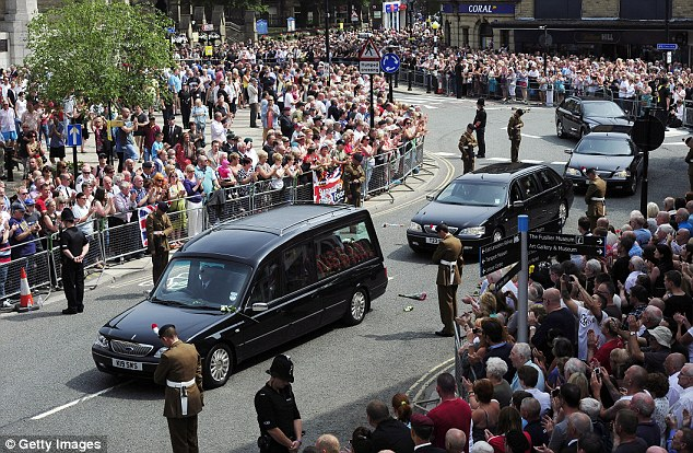Crowds of wellwishers line the street as the funeral cortege of Fusilier Lee Rigby drives away from Bury Parish church on July 12 following a funeral service attended by 800