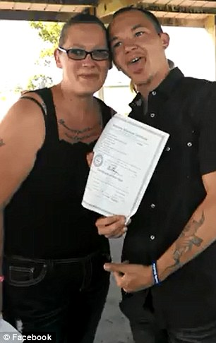 Smith and Ramirez are pictured just before their arrest, as they signed their marriage documents at Oregon Trail Park in Gering, Nebraska