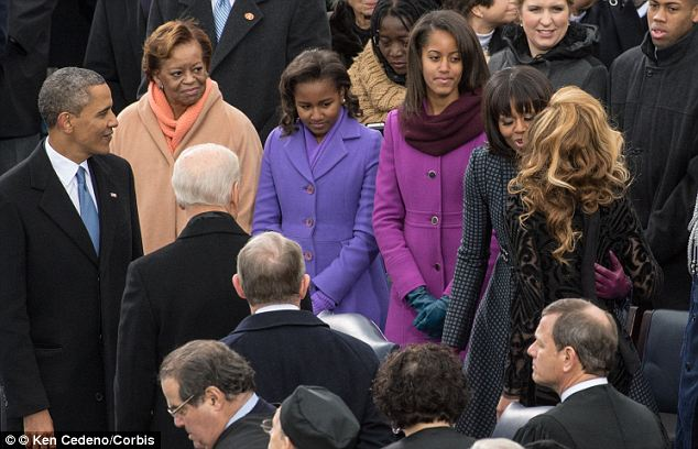 Famous fans: Michelle Obama is reportedly close with Beyonce, as the singer performed at both the President's inauguration weekends (seen here after 'singing' the national anthem)