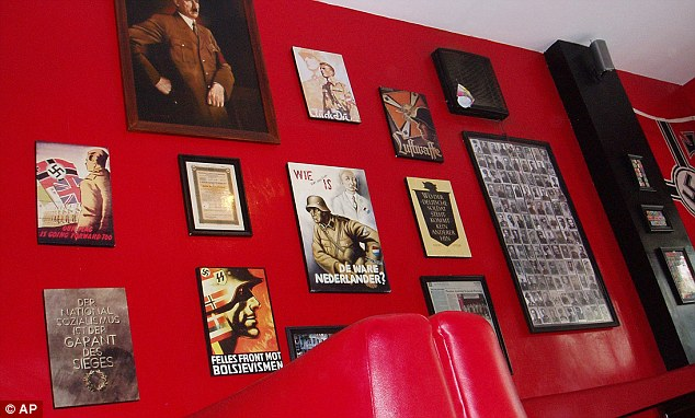 The walls of the cafe which opened in the popular tourist town in 2011 are covered in Nazi memorabilia
