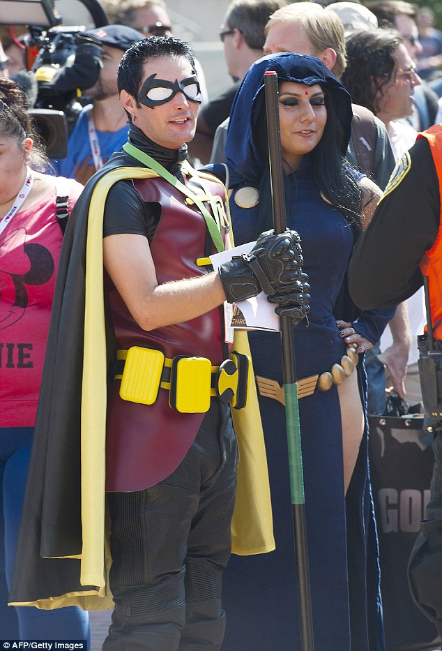 Something for everyone: Costumed attendees wait to cross the street outside Comic-Con 2013