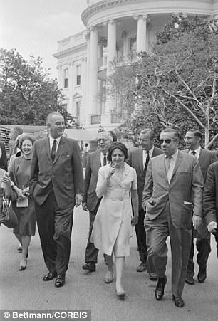 LBJ: Thomas, seen here walking at the White House with President Lyndon Johnson