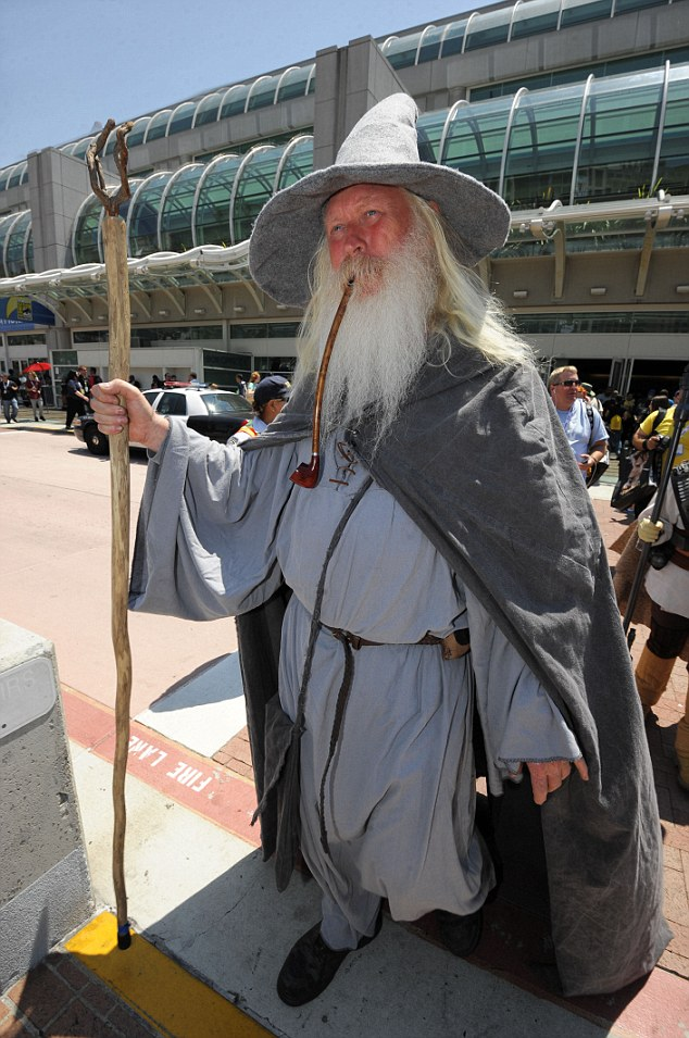 Hold out your hand, Frodo: Wilfred Harris, dressed as Gandalf, walks out of Comic-Con 2013