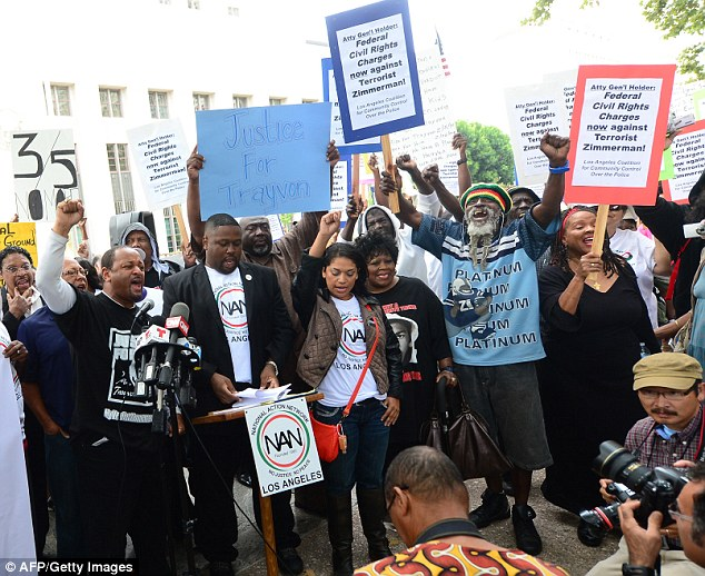 Debate: The rallies, including this one in Los Angeles, were organized to call for civil liberty charges to be brought against Mr Zimmerman