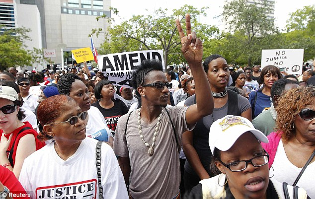 Rally: Crowds gather outside the federal courthouse in Miami as part of a nationwide response to the verdict in the George Zimmerman case