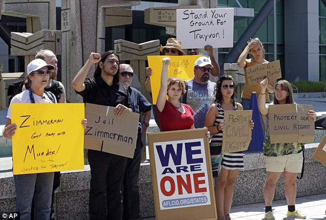 United: In Salt Lake City residents gathered outside the Wallace Bennett Federal Building for the rally