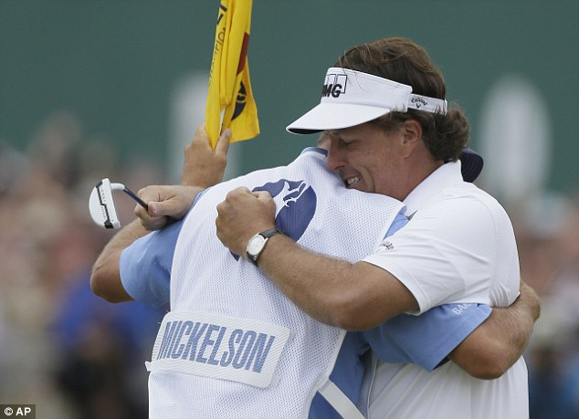 Dem Bones: Phil Mickelson hugs his caddie Jim Mackay after his final round of The Open