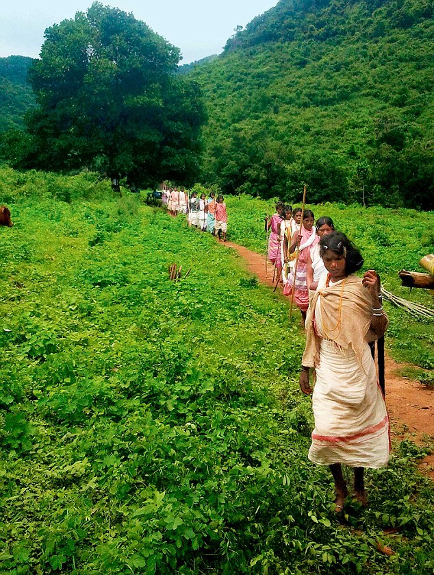 Protest: Dongaria tribe members march to a gram sabha in Serkapedi village