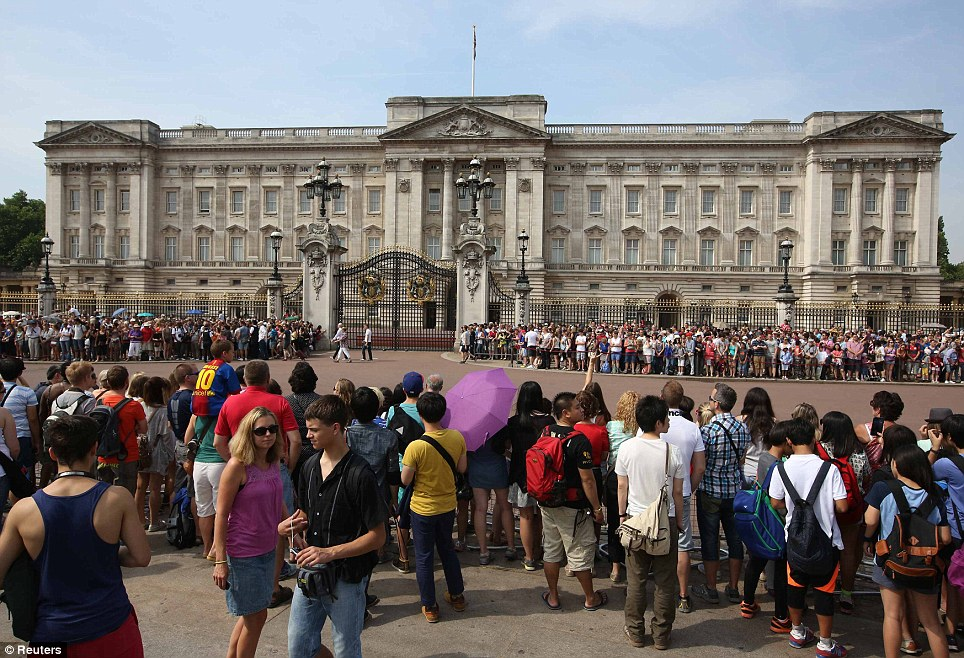 Preparations: Crowds have flocked to the areas outside Buckingham Palace, where the baby's birth will be announced in the coming hours