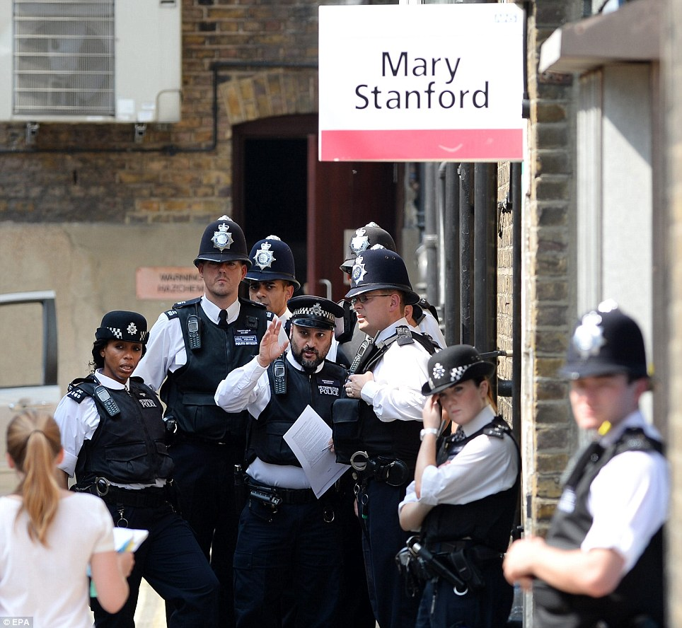 Police presence: A major security operation is underway at the west London hospital with dozens of officers on duty to maintain order
