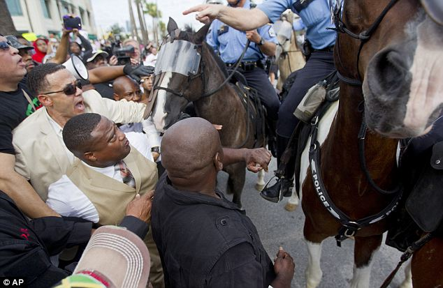 Kept apart: Police officers, many on horseback, kept the crowds moving and separated