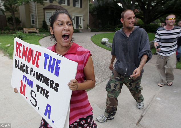 Counter movement: A protestor holds a sign as the G. Zimmerman River Oaks Stand Your Ground group holds a demonstration against community activist Quanell X