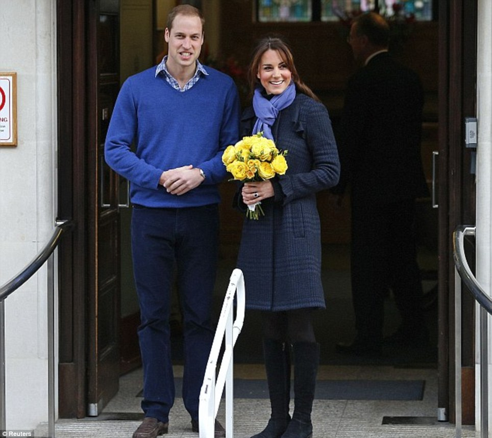 Early days: Prince William leaves the King Edward VII hospital with his wife, where she had spent four days being treated for acute morning sickness at the start of her pregnancy last year