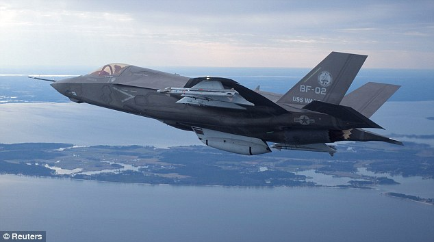 $600 Billion Program: The U.S. Marine Corps version of Lockheed Martin's F35 Joint Strike Fighter, F-35B test aircraft BF-2 flies with external weapons for the first time over Maryland on February 22nd, 2012