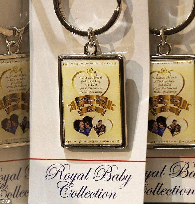 Souvenirs: Key rings which have gone on sale in stores in central London to mark the royal birth