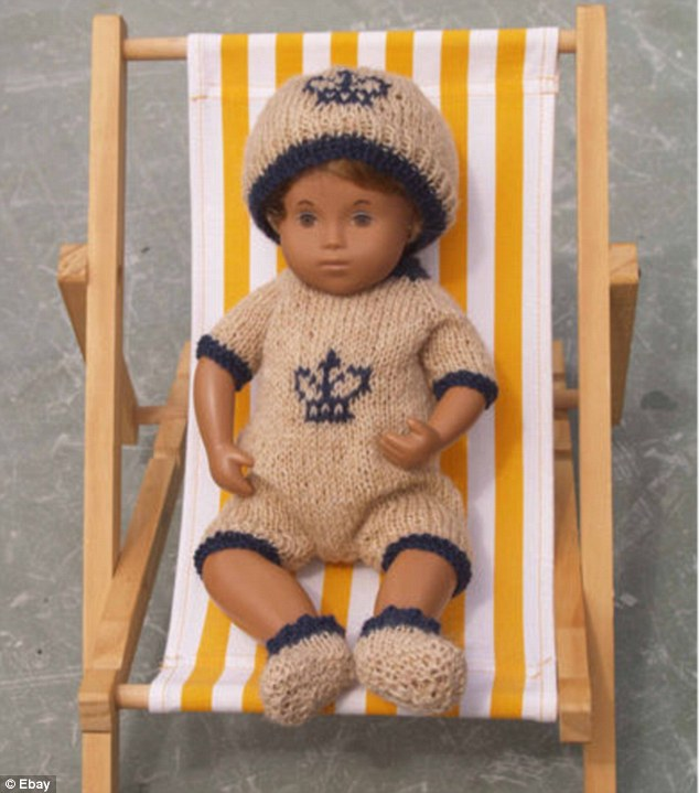 Tacky: A knitted baby outfit which has gone on same on eBay - it consists of a romper suit, hat and shoes