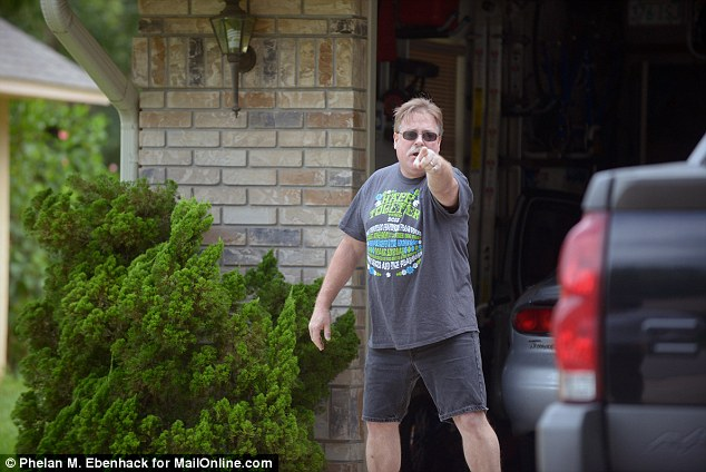 Angry: Mark Gerstle, pictured, yells at reporters to leave the area after arriving home in Port Orange, Florida, Tuesday, July 23, 2013