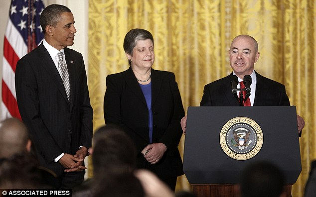 Under investigation: Alejandro Mayorkas (pictured far right) pictured with President Obama and Director of Homeland Security, Janet Napolitano (center)