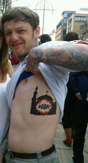 The man is understood to have been pictured revealing the inflammatory tattoo at an EDL rally in Birmingham