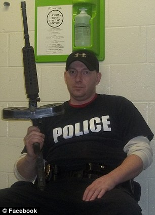 Second Amendment: Mark Kessler sports one of his modified rifles and the uniform of his Constitutional Security Force (right)