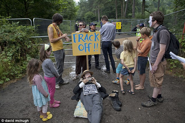 Frack off: Protesters have promised around-the-clock resistance to exploratory drilling for gas at a site in West Sussex