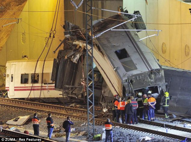 Derailed: All eight carriages of the Madrid to Ferrol train came off the tracks near the city of Santiago de Compostela