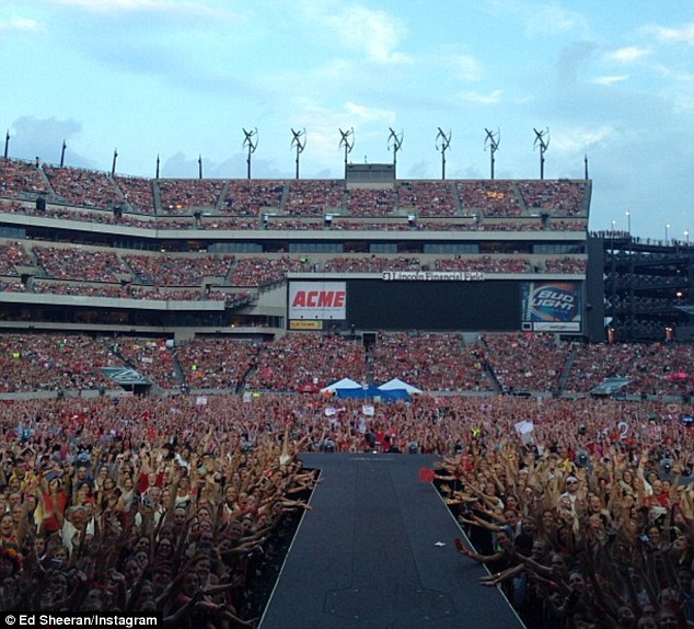 Fan frenzy: The audience at Taylor's Red tour in a snap shared by Ed Sheeran on Instagram