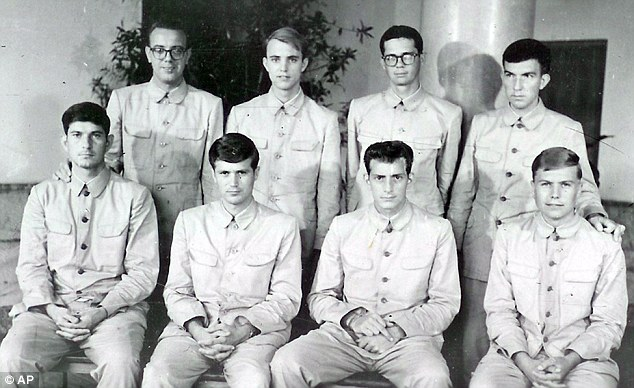 Forced confessions: Crew members of USS Pueblo pose while in captivity in North Korea in 1968