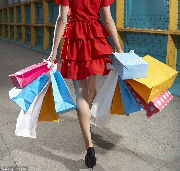 Designer goods: According to a new study from the University of Minnesota, women purchase expensive clothes and accessories so that other women won't steal their man