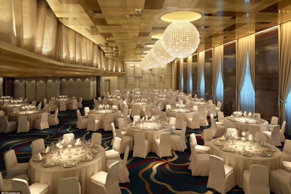 Despite its over-the-top interior (a dining room is pictured), the company behind the super yacht claims it is eco-friendly compared to building a new hotel on land