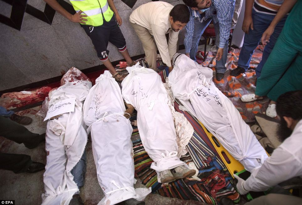 Deadly violence: The bodies of killed supporters of ousted president Mohamed Morsi in a field hospital at Rabaa Adawiya mosque following clashes with security forces in Cairo