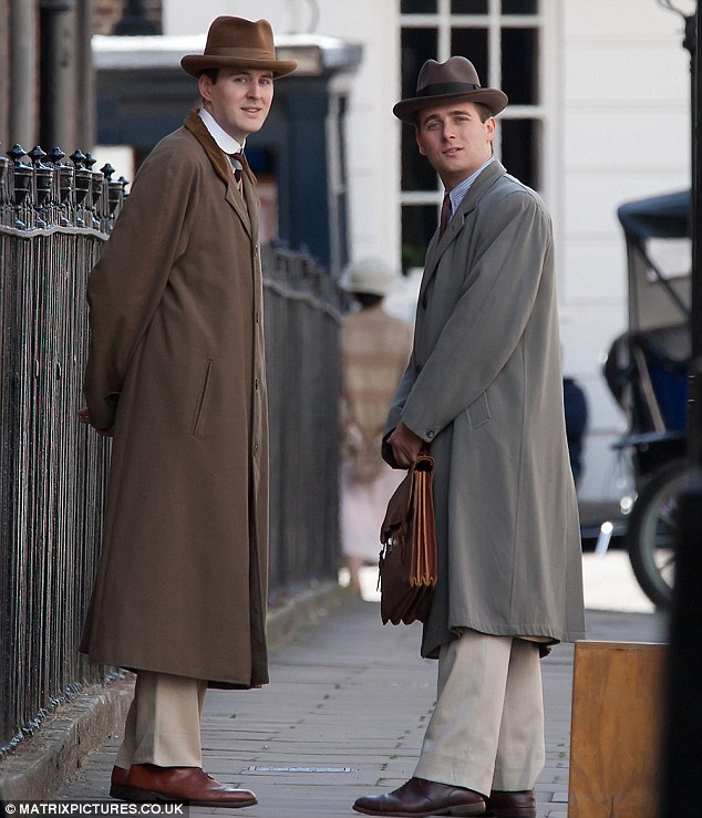 Dapper dudes: The cast looked smart in tailored overcoats and trilbies as they got to work on set in London