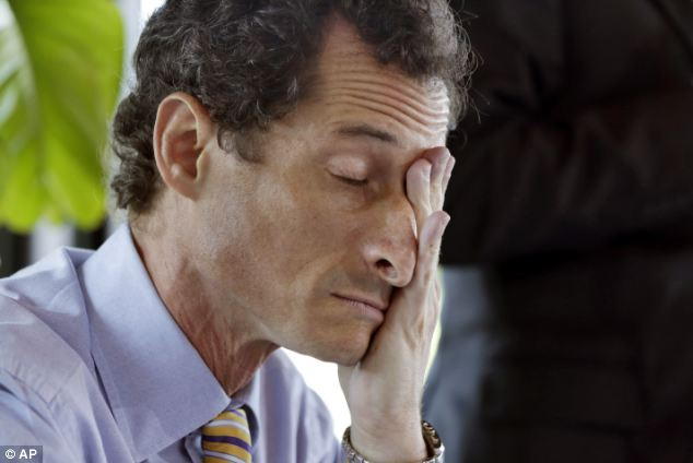 Need a break? New York mayoral candidate Anthony Weiner rubs his eyes during a candidate forum on small business in Manhattan on Monday as his latest sexting scandal refuses to go away