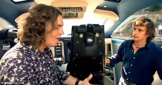 Impressed: Top Gear presenters James May and Richard Hammond pictured aboard the futuristic craft. The show saw the boat being raced against a Ferrari Daytona in the South of France