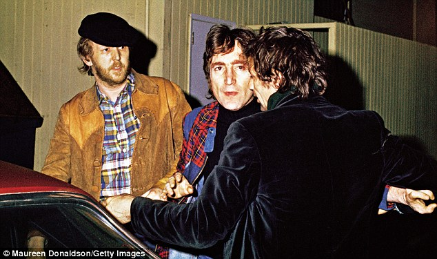 Lennon and Nilsson are thrown out of the Troubador in LA on March 13, 1974, for heckling