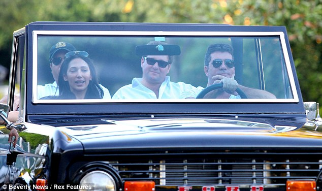 Cosy: Simon Cowell, Lauren Silverman and Andrew Silverman go house hunting in Los Angeles in October 2012