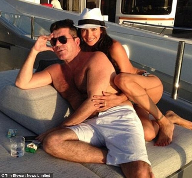 Close: Simon Cowell and Lauren on his yacht in January of this year