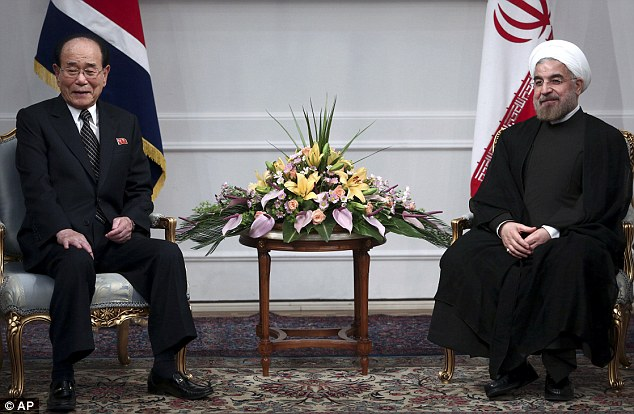 Allegations: Iran's new president Hasan Rouhani (right) told a top North Korean official, Kim Yong Nam, that America wants an excuse to confront Iran over its nuclear programme