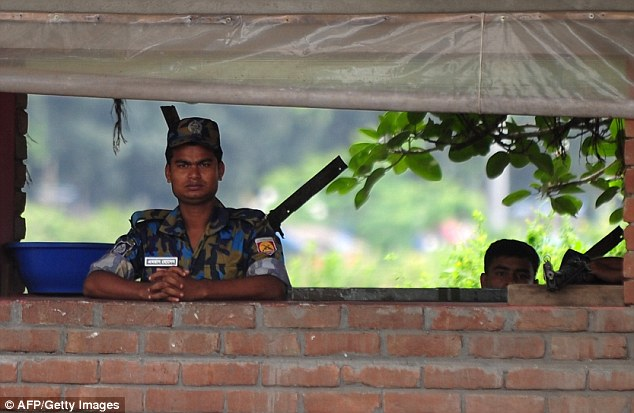 Bangladeshi policemen stand guard outside the US embassy in Dhaka on Sunday