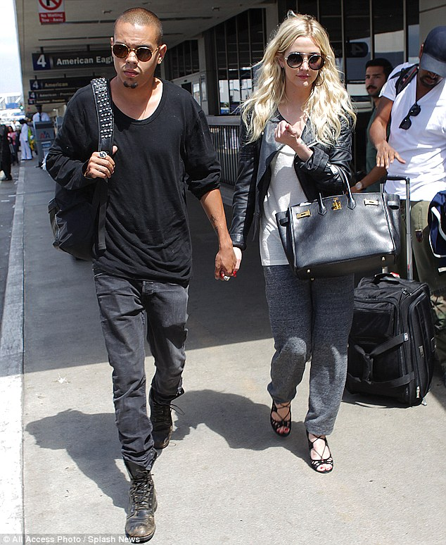 New romance: Ashlee Simpson and Evan Ross were spotted walking hand in hand at Los Angeles airport on July 31