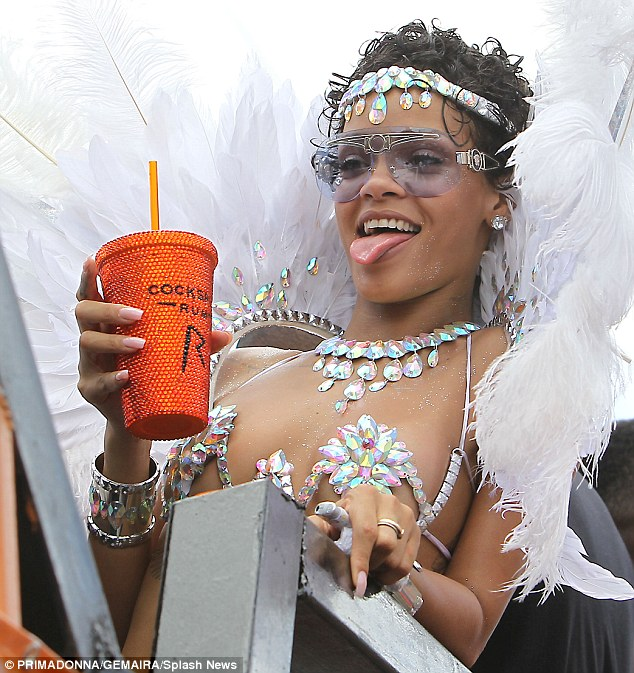 Change of pace: Rihanna was also seen sipping out of a rhinestone-encrusted cup complete with straw
