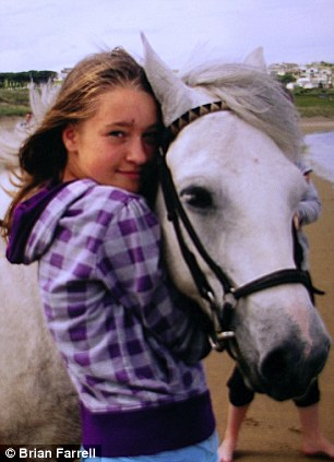 Hurt: Ciara Pugsley was also bullied online, which led to her death, pictured here with her pony at Mullaghmore in Ireland