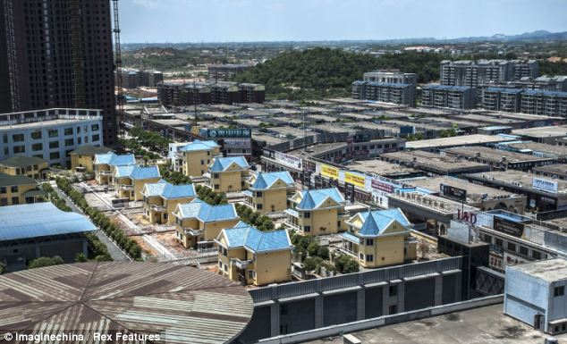 New homes: Authorities say developers cannot sell the houses and they are now lived in by migrant workers