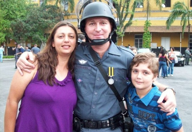Slaughter: 13-year-old Marcelo Pesseghini with his police officer parents Luiz and Andreia, who he shot dead in the early hours of Monday morning before setting off to school