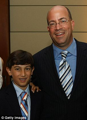 Connected: Andrew Zucker, who is now 14 but is pictured here with his father Jeff in 2009, is listed as a member of Waywire's advisory board